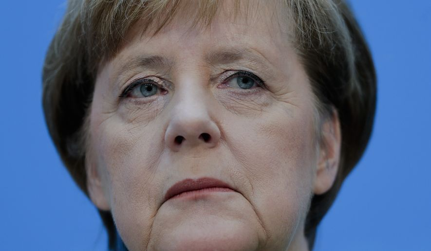 German Chancellor Angela Merkel addresses a news conference after a party's leaders meeting in Berlin, Germany, Monday, Feb. 19, 2018. (AP Photo/Markus Schreiber)