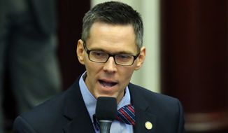 Rep. Ross Spano, R-Dover, speaks in support of an education bill during session, Friday, April 24, 2015, in Tallahassee, Fla.  (AP Photo/Steve Cannon)
