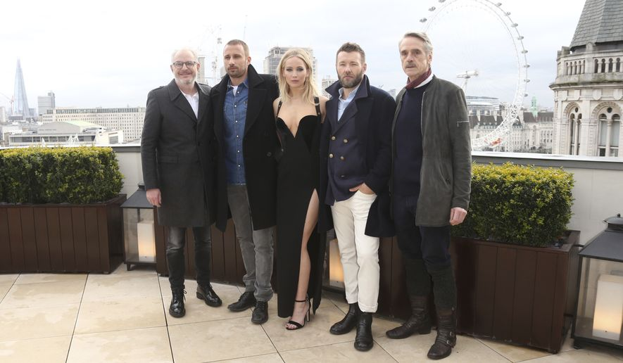 Actors Jeremy Irons, from right, Joel Edgerton, Jennifer Lawrence, Matthias Schoenaerts and director Francis Lawrence pose for photographers at the photo call for the film 'Red Sparrow' in London, Tuesday, Feb. 20, 2018. (Photo by Joel C Ryan/Invision/AP)