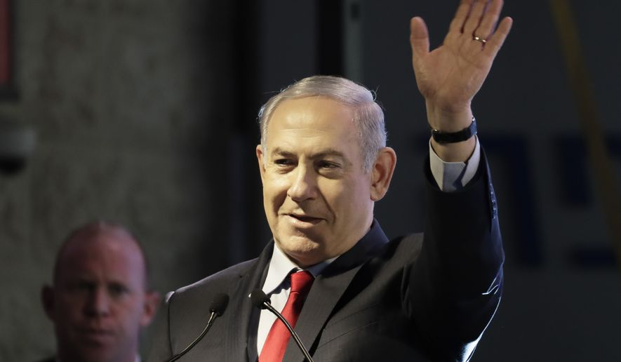 Israeli Prime Minister Benjamin Netanyahu waves during the opening ceremony for a bomb-proof emergency room in a hospital in Ashkelon, Israel, Tuesday, Feb. 20, 2018. (AP Photo/Tsafrir Abayov)