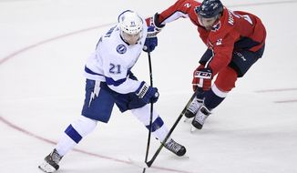 Washington Capitals defenseman Matt Niskanen (2) tries to disrupt a pass by Tampa Bay Lightning center Brayden Point (21) during the third period of an NHL hockey game, Tuesday, Feb. 20, 2018, in Washington. The Lightning won 4-2. (AP Photo/Nick Wass)