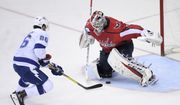 Tampa Bay Lightning right wing Nikita Kucherov (86), of Russia, scores a goal against Washington Capitals goaltender Braden Holtby (70) during the third period of an NHL hockey game Tuesday, Feb. 20, 2018, in Washington. The Lightning won 4-2. (AP Photo/Nick Wass) **FILE**