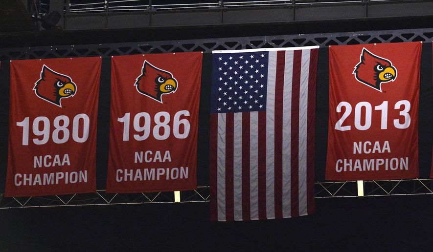 Three National Championship banners hang from the rafters at the KFC Yum! Center, the home of the University of Louisville men's basketball team, Saturday, Feb. 3, 2018, in Louisville, Ky.  Louisville must vacate its 2013 men's basketball title following an NCAA appeals panel's decision to uphold sanctions against the men's program in the sex scandal case. The Cardinals will have to vacate 123 victories including the championship, and return some $600,000 in conference revenue from the 2012-15 NCAA Tournaments. (AP Photo/Timothy D. Easley)