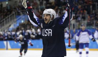 Garrett Roe (11), of the United States, celebrates after scoring a goal against Slovakia during the third period of the qualification round of the men's hockey game at the 2018 Winter Olympics in Gangneung, South Korea, Tuesday, Feb. 20, 2018. (AP Photo/Julio Cortez)