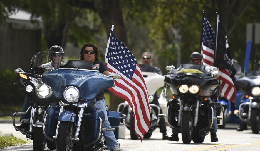 Members of the Florida state patriot guard riders arrive at the funeral services for slain Marjory Stoneman Douglas student Carmen Schentrup, Tuesday, Feb. 20, 2018, at St. Andrews Catholic Church in Coral Springs, Fla. (Joe Cavaretta/South Florida Sun-Sentinel via AP) ** FILE **