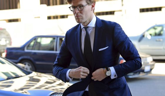 Alex van der Zwaan arrives at Federal District Court in Washington, Tuesday, Feb. 20, 2018. Van der Zwaan has been accused of lying to investigators about his interactions with Rick Gates, who was indicted last year along with Paul Manafort, President Donald Trump's campaign chairman, on charges of conspiracy to launder money and acting as an unregistered foreign agent. (AP Photo/Susan Walsh)