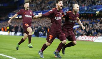 Barcelona's Lionel Messi celebrates scoring his side's first goal during a Champions League round of sixteen first leg soccer match between FC Barcelona and Chelsea at Stamford Bridge stadium in London, Tuesday, Feb. 20, 2018. (AP Photo/Alastair Grant)