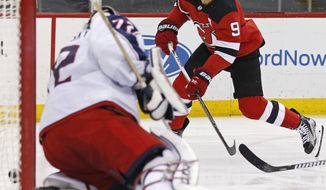 New Jersey Devils left wing Taylor Hall (9) scores a goal past Columbus Blue Jackets goaltender Sergei Bobrovsky (72) during the second period of an NHL hockey game Tuesday, Feb. 20, 2018, in Newark, N.J. (AP Photo/Adam Hunger)