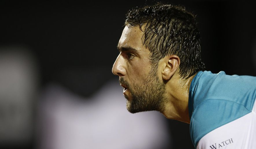 Croatia's Marin Cilic stands ready during his game against Argentina's Carlos Berlocq at the Rio Open tennis tournament in Rio de Janeiro, Brazil, Monday, Feb. 19, 2018. (AP Photo/Silvia Izquierdo)