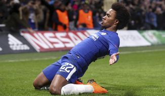 Chelsea's Willian, celebrates scoring his side's first goal of the game during the Champions League round of sixteen first leg soccer match between FC Barcelona and Chelsea at Stamford Bridge stadium in London, Tuesday, Feb. 20, 2018. (Adam Davy/PA via AP)