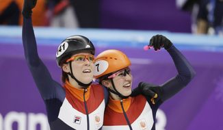 CORRECTS NAME FROM JORIEN TER MORE TO JORIEN TER MORS - Netherlands' Jorien ter Mors and Suzanne Schulting celebrate during their women's 3000 meters short track speedskating relay B final in the Gangneung Ice Arena at the 2018 Winter Olympics in Gangneung, South Korea, Tuesday, Feb. 20, 2018. (AP Photo/Bernat Armangue)