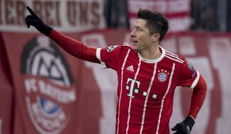 Bayern's Robert Lewandowski celebrates after scoring his side's fourth goal during the Champions League round of 16 first leg soccer match between Bayern Munich and Besiktas Istanbul in Munich, southern Germany, Tuesday, Feb. 20, 2018.  (Sven Hoppe/dpa via AP)