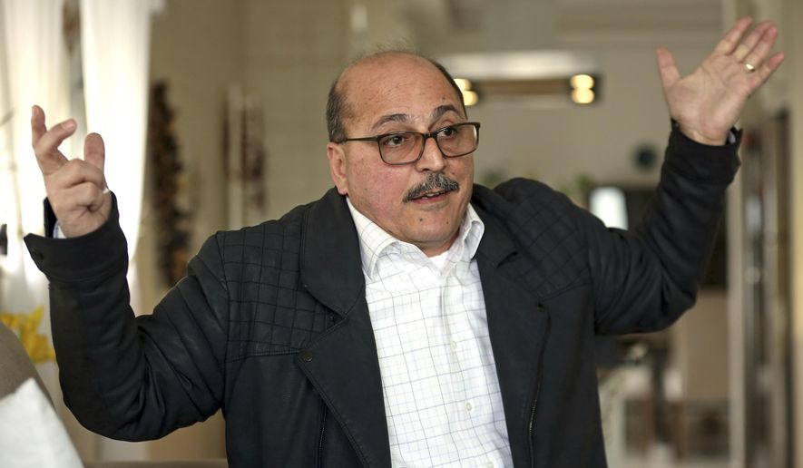 In this Thursday, Feb. 15, 2018 photo, Amer Othman, 57, speaks during an interview with The Associated Press in Amman, Jordan. Othman's life turned upside down in an instant: The Ohio entrepreneur who came to the United States 38 years ago and won praise for helping revive once-blighted downtown Youngstown, was arrested during what he thought was another check-in with immigration authorities. He was detained for two weeks and deported to his native Jordan. (AP Photo/Raad Adayleh)