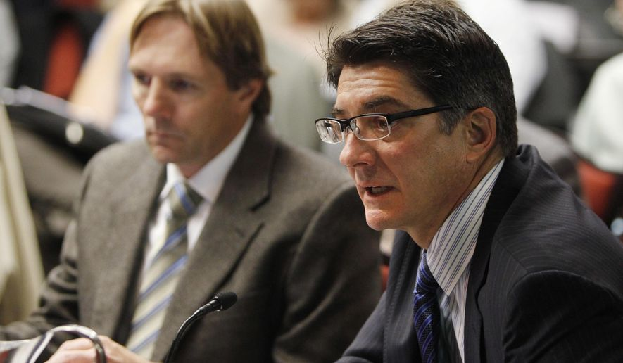 FILE - In this Nov. 14, 2012 file photo, Matthew Lepore, right, director of the Oil & Gas Conservation Commission, and Jim Milne, Environmental Manager, testify on ground water issues at a meeting of the Colorado Oil and Gas Conservation Commission in Denver. Lepore is resigning to become legal counsel and strategic adviser for Adamantine Energy, a Denver consulting group that works with energy companies dealing with regulators, activists, investors and others. The Oil and Gas Conservation Commission said Tuesday, Feb. 20, 2018 that Director Matt Lepore is resigning on March 4 after more than five years in the job. (AP Photo/Ed Andrieski, File)