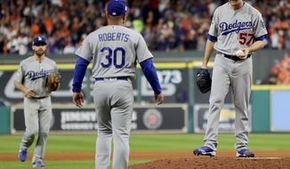 FILE - In this Oct. 18, 2017, file photo, Los Angeles Dodgers manager Dave Roberts walks out to pitcher Alex Wood during the sixth inning of Game 4 of baseball's World Series against the Houston Astros, in Houston. Major League Baseball is imposing stricter limits on mound visits in an effort to speed games but decided against 20-second pitch clocks for 2018. The new rules announced Monday, Feb. 19, 2018, include a general limit of six mound visits per nine-inning game without a pitching change, whether by a manager, coach or player.(AP Photo/Matt Slocum)