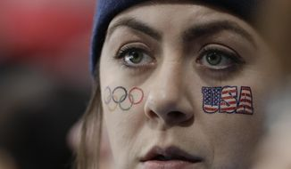 A fan from United States watches women's curling matches at the 2018 Winter Olympics in Gangneung, South Korea, Tuesday, Feb. 20, 2018. (AP Photo/Natacha Pisarenko)