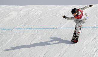 Jamie Anderson, of the United States, lands during qualification for the women's big air snowboard competition at the 2018 Winter Olympics in Pyeongchang, South Korea, Monday, Feb. 19, 2018. (AP Photo/Kirsty Wigglesworth)
