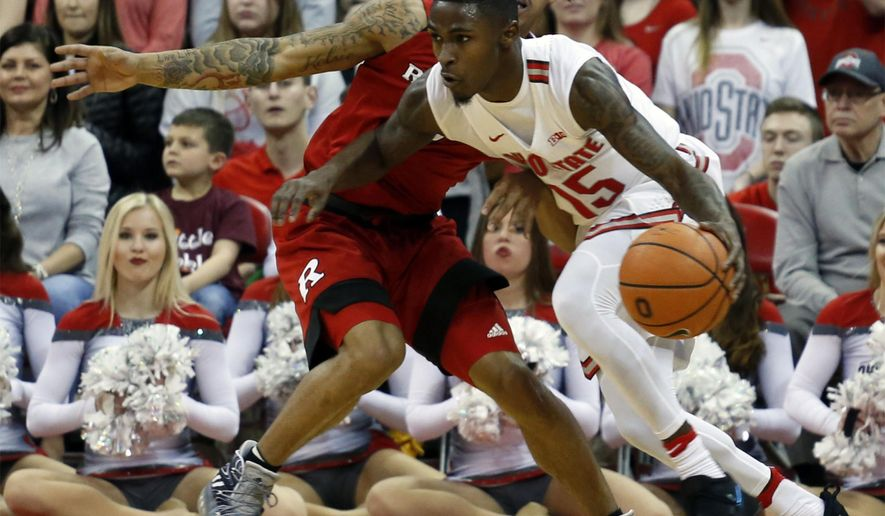 Ohio State's Kam Williams, front, drives to the basket against Rutgers' Corey Sanders during the first half of an NCAA college basketball game Tuesday, Feb. 20, 2018, in Columbus, Ohio. (AP Photo/Jay LaPrete)