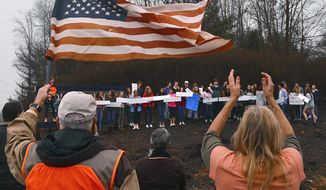 Around 50 Polk County High School students participate in a walk-out from school on Tuesday, Feb. 20, 2018 in Columbus, N.C. The students protested the epidemic of mass shootings in American schools, speaking in front of the school's sign along Hwy. 108 in Columbus, NC as supporters cheered them on. (Tim Kimzey/The Spartanburg Herald-Journal via AP)