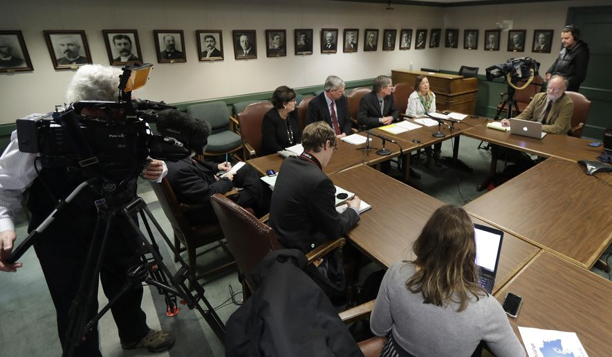 House Democrat leaders, center, talk to reporters about their proposed supplemental budget, Tuesday, Feb. 20, 2018, during a news conference at the Capitol in Olympia, Wash. The budget proposal sticks to an education funding timeline that the state Supreme Court has previously rejected and also includes a capital gains tax for long-term property tax relief. (AP Photo/Ted S. Warren)