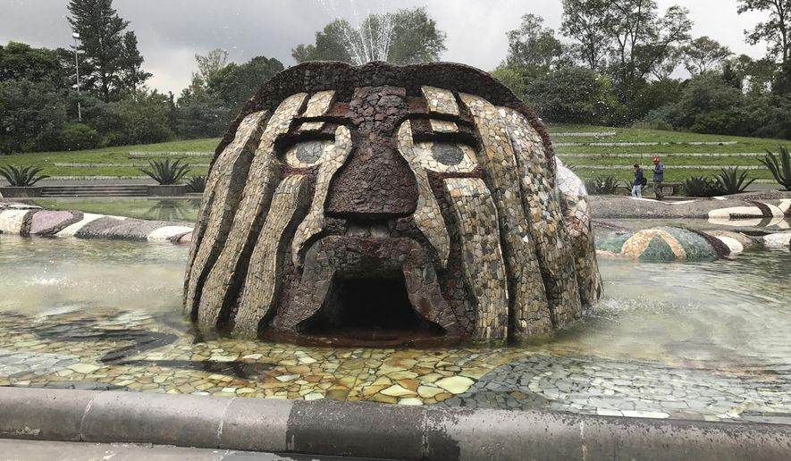 "In this photo taken on Sept. 5, 2017, a fountain that Diego Rivera designed featuring the Aztec rain god Tlaloc, stands outside a hydraulic structure called the Carcamo de Dolores, or the Dolores Sump. The monument inside the Second Section of the Mexican capital's Chapultepec Park features a little-known Rivera mural painted to honor Mexico City's water system, called ""Water, the Source of Life."" (AP Photo/Anita Snow)"