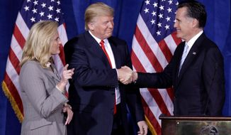 FILE - In this Thursday, Feb. 2, 2012 file photo, Donald Trump greets Republican presidential candidate, former Massachusetts Gov. Mitt Romney, after announcing his endorsement of Romney during a news conference in Las Vegas. Trump is endorsing Romney in Utah's Senate race, another sign that the two Republicans are burying the hatchet after a fraught relationship. (AP Photo/Julie Jacobson, File)