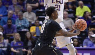 LSU forward Aaron Epps (21) defends against Vanderbilt guard Saben Lee (0) during an NCAA college basketball game Tuesday, Feb. 20, 2018, in Baton Rouge, La. (Hilary Scheinuk/The Advocate via AP)