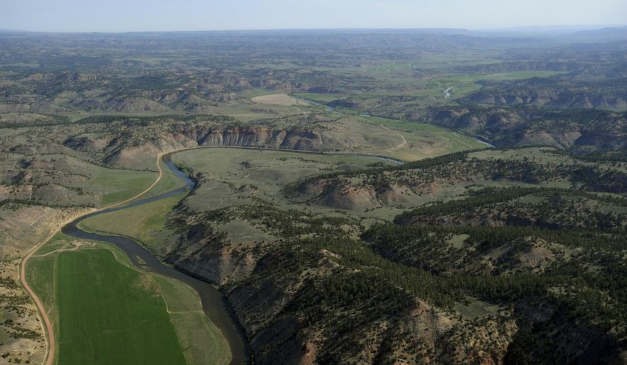 FILE - This May 25, 2013, file photo shows an aerial view of the Tongue River along the Montana-Wyoming border near Decker, Mont. The U.S. Supreme Court has ordered the state of Wyoming to pay Montana over $38,000 in damages and interest and $67,000 in court costs in a long-running dispute over water rights that affect farmers and ranchers on both sides of the border. (Larry Mayer/The Gazette via AP, file)