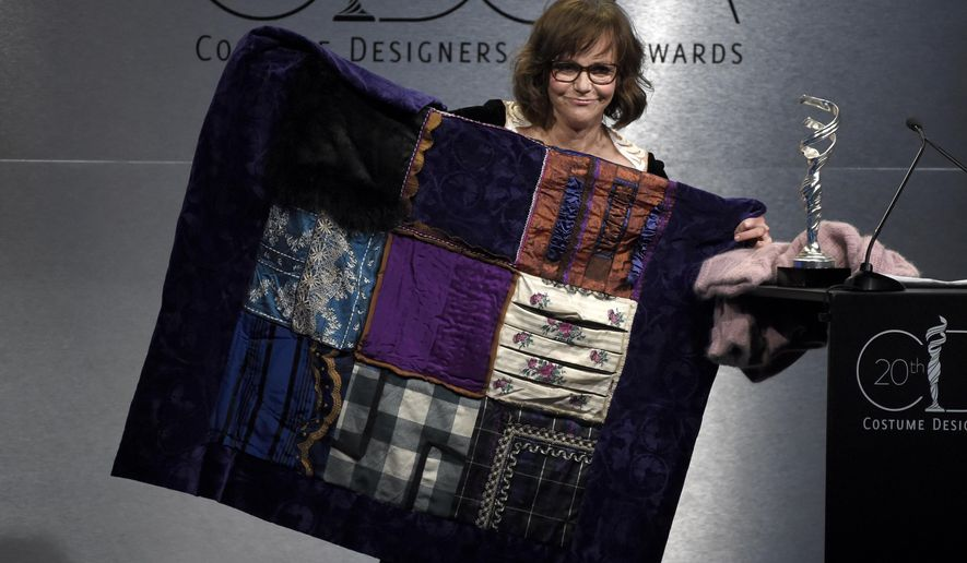 "Sally Field holds up a quilt made from her character's costumes in the film ""Lincoln"" at the 20th annual Costume Designers Guild Awards at The Beverly Hilton hotel on Tuesday, Feb. 20, 2018, in Beverly Hills, Calif. (Photo by Chris Pizzello/Invision/AP)"