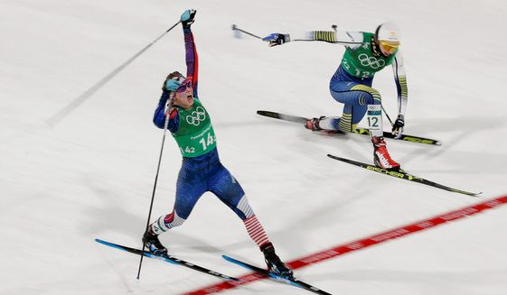 American Jessica Diggins celebrates as she crosses the finish line past Sweden's Stina Nilsson to win the United States' first medal ever in the women's team sprint freestyle cross-country skiing at the Winter Olympics in Pyeongchang, South Korea, on Wednesday. (ASSOCIATED PRESS PHOTOGRAPHS)