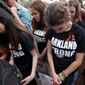 Student survivors from Marjory Stoneman Douglas High School bow their heads as victims' names are read at the state capitol in Tallahassee, Florida, on Wednesday. (Associated Press)