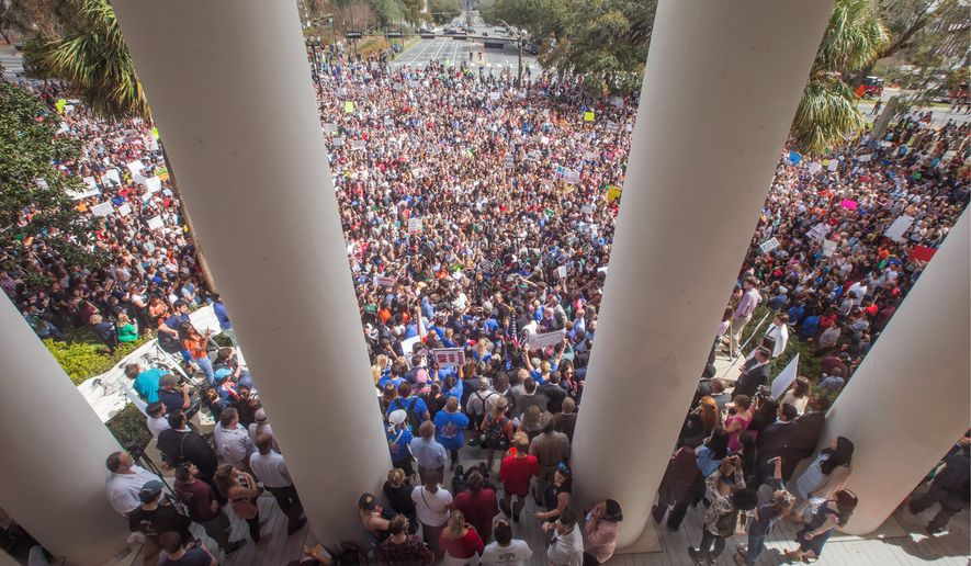 Protesters rally against gun violence on the steps of the old Florida Capitol in Tallahassee, Florida, on Wednesday. Students at schools across Broward and Miami-Dade counties in South Florida planned short walkouts Wednesday, the one week anniversary of the deadly shooting at Marjory Stoneman Douglas High School. (ASSOCIATED PRESS PHOTOGRAPHS)