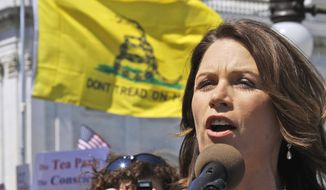"""FILE - In this April 6, 2011 file photo, Rep. Michele Bachmann, R-Minn. addresses an Americans for Prosperity """"Cut Spending Now,"""" rally on Capitol Hill in Washington. It's the weird issue that won't go away, and it's forcing GOP presidential contenders and other Republican leaders to pick sides: do they think President Obama was born outside the United States and is therefore disqualified to be president? Polls show that a remarkable  two-thirds of all Republican voters either think Obama was born abroad or they aren't sure. With Donald Trump stirring the pot, other potential candidates are distancing themselves from his comments to varying degrees. (AP Photo/Alex Brandon, File)"""