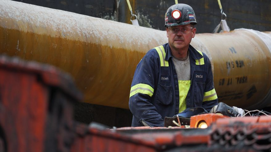 A miner runs a coal continuous miner at a coal mine in Friedens, Pa., Wednesday, June 7, 2017. Corsa Coal Corp. says the mine will create 70 to 100 new jobs and produce some 400,000 tons of metallurgical coal a year. President Donald Trump referred to the mine's opening during a speech announcing his intent to withdraw from the Paris climate accords. (AP Photo/Dake Kang)