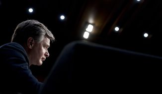 FBI Director Christopher Wray attends a Senate Select Committee on Intelligence hearing on worldwide threats, Tuesday, Feb. 13, 2018, in Washington. (AP Photo/Andrew Harnik)