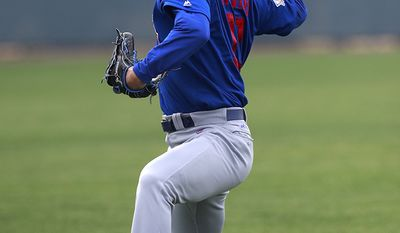 YU DARVISH - Chicago Cubs starting pitcher Yu Darvish throws during a practice session at the team's spring training baseball facility Friday, Feb. 16, 2018, in Mesa, Ariz. (AP Photo/Carlos Osorio)