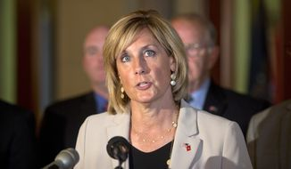 """FILE - In this June 10, 2015 file photo, assemblywoman Claudia Tenney, R-New Hartford, speaks during a news conference at the Capitol, in Albany, N.Y. The Republican congresswoman from upstate New York says """"many"""" people who commit mass murder are Democrats. U.S. Rep. Tenney made the comment Wednesday, Feb. 21, 2018, on Talk 1300 Radio during a discussion about calls for stricter gun control since last week's deadly Florida high school shooting. (AP Photo/Mike Groll, File)"""