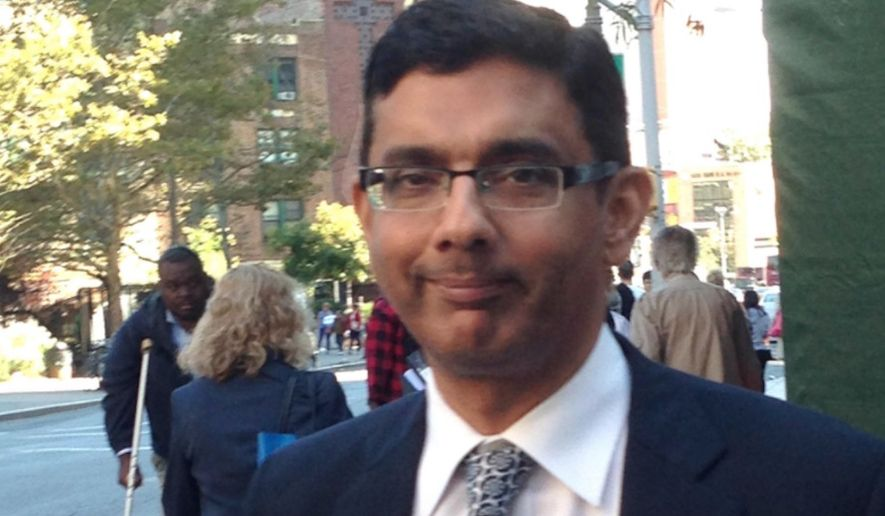Dinesh D'Souza leaves federal court in New York, Tuesday, Sept. 23, 2014, after being sentenced to spend eight months in community confinement and undergo therapeutic counseling for arranging straw donors for a Senate candidate. D'Souza was spared from prison even though U.S. District Judge Richard M. Berman said the defendant continues to deflect responsibility and minimize his crime. (AP Photo/Larry Neumeister) ** FILE **