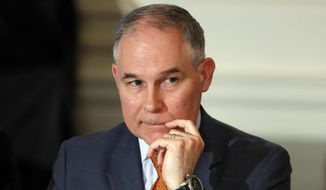 In this Feb. 12, 2018, file photo, Environmental Protection Agency Administrator Scott Pruitt attends a meeting with state and local officials and President Donald Trump at the White House in Washington. (AP Photo/Carolyn Kaster, File)