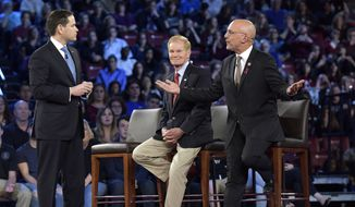Democratic Rep. Ted Deutch of Florida, right, disagrees with Sen. Marco Rubio during a CNN town hall meeting, Wednesday, Feb/ 21, 2018, at the BB&T Center, in Sunrise, Fla. (Michael Laughlin/South Florida Sun-Sentinel via AP)