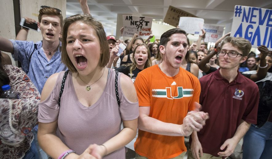Students chant protest slogans outside the Florida House of Representatives chamber inside the Florida Capitol in Tallahassee, Fla., Feb 21, 2018.  Students at schools across Broward and Miami-Dade counties in South Florida planned short walkouts Wednesday, the one week anniversary of the deadly shooting at Marjory Stoneman Douglas High School.  (AP Photo/Mark Wallheiser)