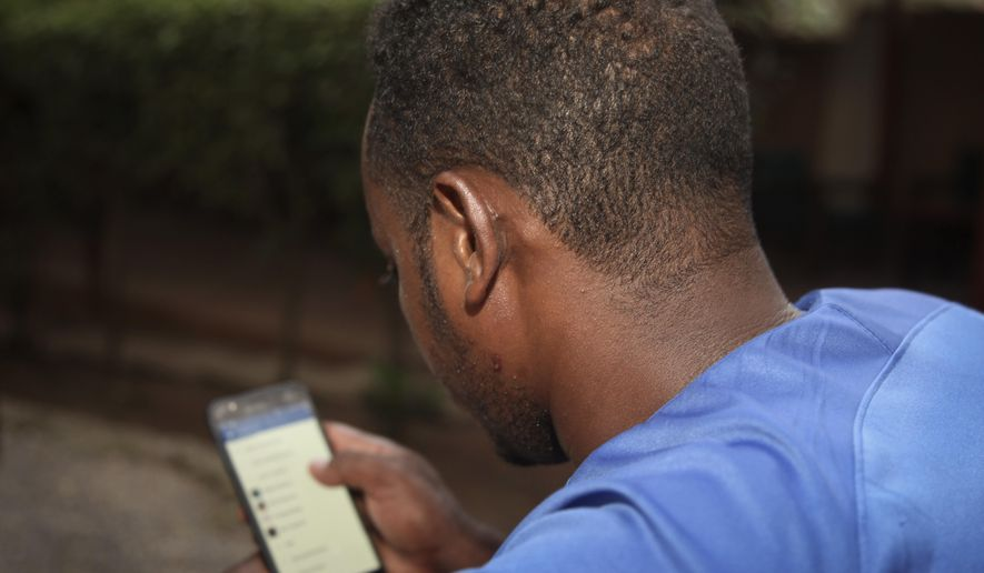 An estimated 19 million low-income Ugandans have effectively lost access to Facebook, WhatsApp, Skype and other apps as a result on the Ugandan tax, which took effect on July 1. (Associated Press/File)