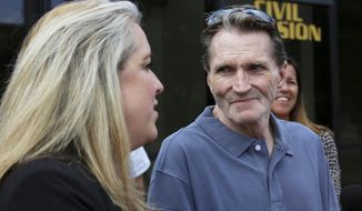 FILE - In this May 30, 2017 file photo, William Amor, right, watches as his attorney, Lauren Kaeseberg with the University of Illinois-Springfield's Illinois Innocence Project, speaks to the media after he was released from DuPage County jail in Wheaton, Ill.  Amor, who spent 22 years behind bars on charges of arson and murder in his mother-in-law's death was found not guilty by a judge Wednesday, Feb. 21, 2018 in the retrial of his case. (Bev Horne/Daily Herald via AP, File)