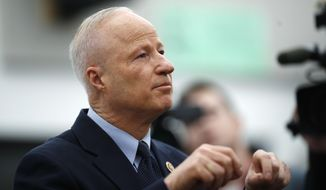 U.S. Rep. Mike Coffman, R-Colorado, talks during a news conference before a town hall meeting with constituents in a high school assembly hall Tuesday, Feb. 20, 2018, in Greenwood Village, Colo. Coffman was peppered with questions about gun control in the wake of the mass shooting in south Florida last week. (AP Photo/David Zalubowski)