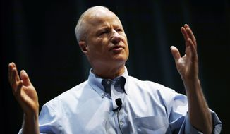 U.S. Rep. Mike Coffman, R-Colorado, talks during a town hall meeting with constituents in a high school assembly hall Tuesday, Feb. 20, 2018, in Greenwood Village, Colo. (AP Photo/David Zalubowski)