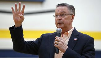 FILE - In this May 11, 2017, file photo, Rep. Rod Blum, R-Iowa, speaks during a town hall meeting in Marshalltown, Iowa. Blum has likely violated multiple House ethics rules by failing to disclose a new company that he founded, using an official photo on its website, and having an aide appear in a false testimonial for its services, a review by The Associated Press shows. Blum, a Republican facing a competitive race for re-election, is one of two directors of the Tin Moon Corporation, a digital marketing company incorporated in 2016 as Blum was in his first term, a business filing shows. (AP Photo/Charlie Neibergall, File)