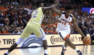 Virginia's De'Andre Hunter (12) drives past Georgia Tech's Moses Wright (12) during the first half of an NCAA college basketball game Wednesday, Feb. 21, 2018, in Charlottesville, Va. (Zack Wajsgras/The Daily Progress via AP) **File**