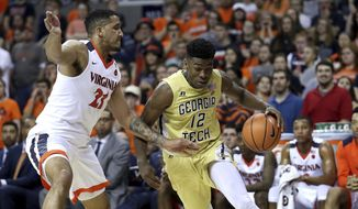 Georgia Tech's Moses Wright (12) drives past Virginia's Isaiah Wilkins (21) during the first half of an NCAA college basketball game Wednesday, Feb. 21, 2018, in Charlottesville, Va. (Zack Wajsgras/The Daily Progress via AP)