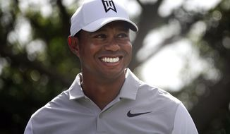 Tiger Woods smiles as he jokes with his playing partners during the Pro-Am for the Honda Classic golf tournament, Wednesday, Feb. 21, 2018, in Palm Beach Gardens, Fla.  (Joe Cavaretta/South Florida Sun-Sentinel via AP)
