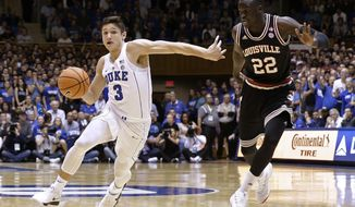 Duke's Grayson Allen (3) dribbles while Louisville's Deng Adel (22) defends during the first half of an NCAA college basketball game in Durham, N.C., Wednesday, Feb. 21, 2018. (AP Photo/Gerry Broome)